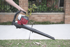 a man is using best commercial leaf vacuum