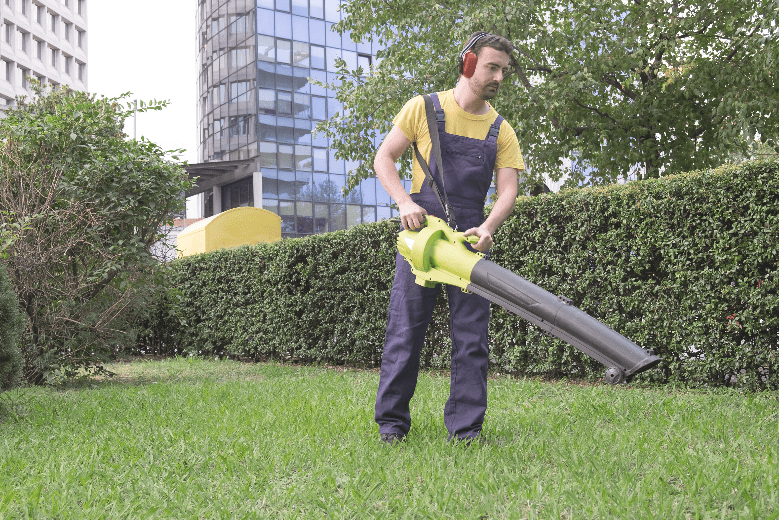 a man is using a commercial leaf vaccum