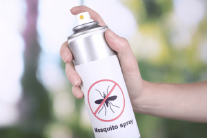 A man is using the best mosquito yard spray