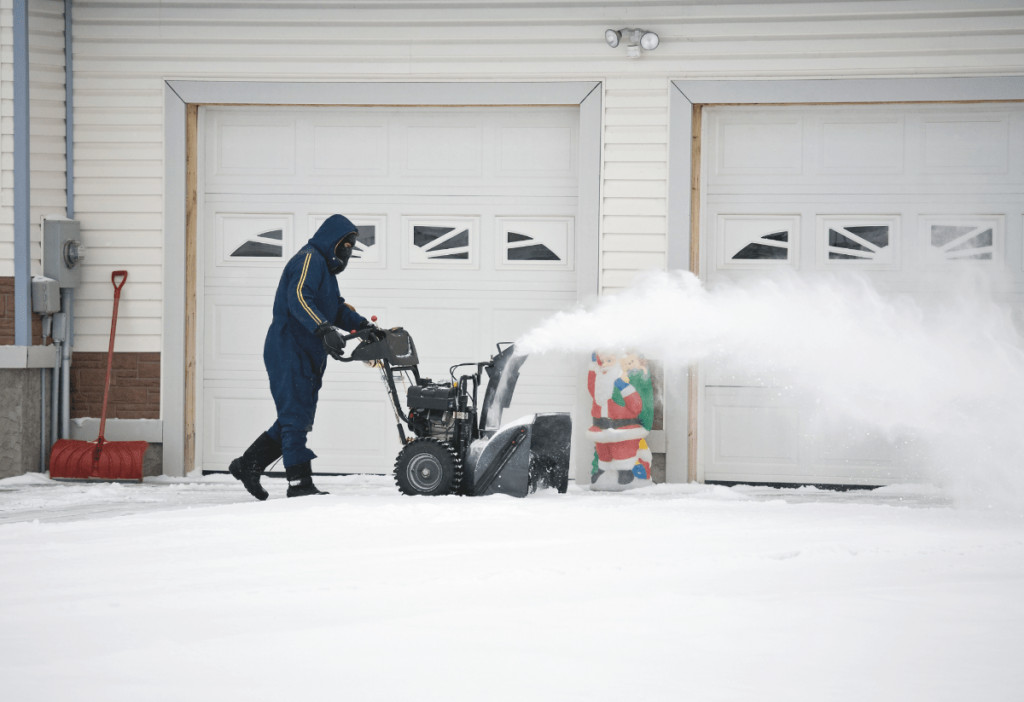 a man is using a cordless snow blower to clean the snow
