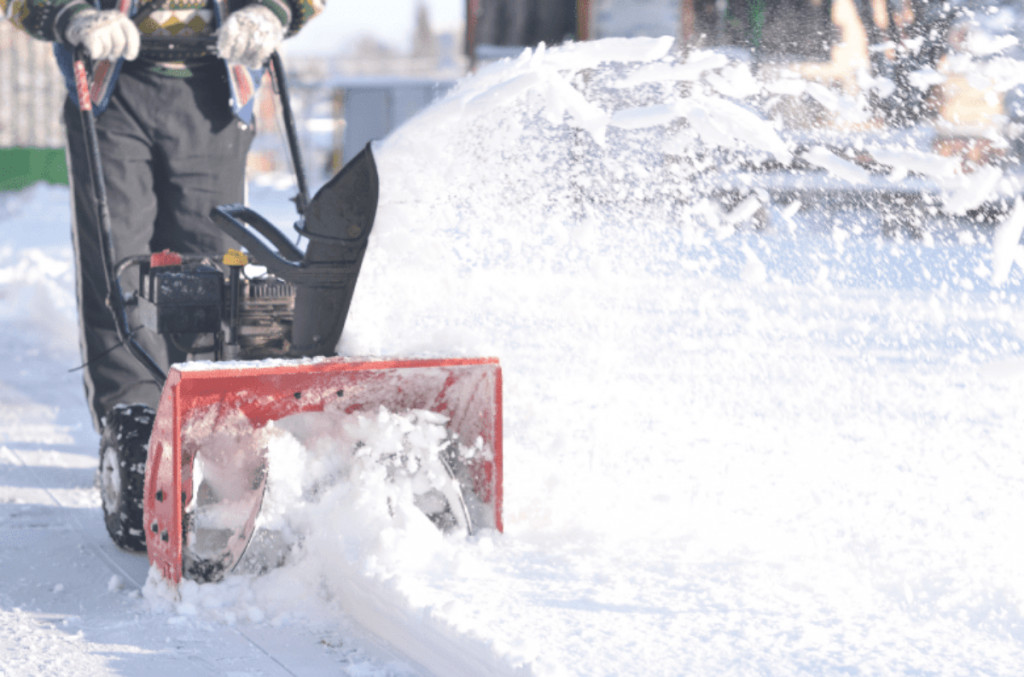 a cordless snow blower is working