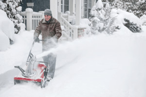 a man is using the best cordless snow blower