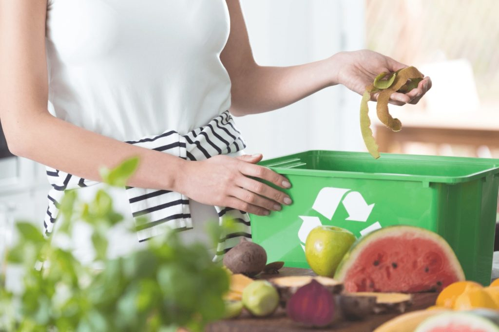 a woman is doing apartment composting without worms
