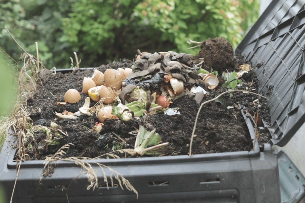 A compost pile is waiting to use the best compost aerators